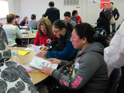 Students practice reading and writing exercises to improve their English skills in the Family Learning Program classes at Crestwood Elementary School.