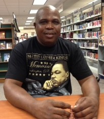 "ESOL student, Teejan, wearing a Martin Luther King, Jr. t-shirt while reading the ""I Have a Dream Speech"""